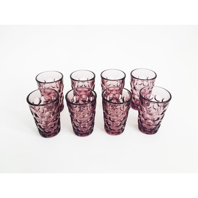 A sweet set of 8 vintage tumblers in a lovely dark purple color. Each tumbler has textured circle pattern on the outside...