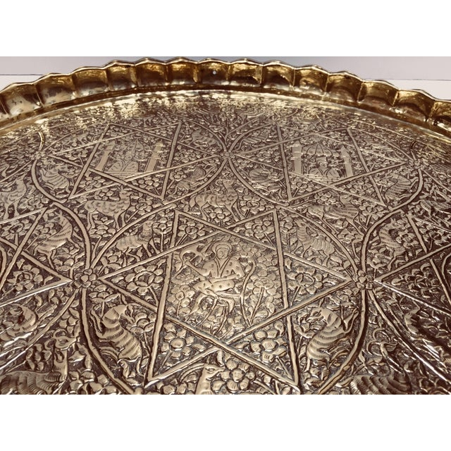 Large handcrafted decorative Indo-Persian brass tray. Embossed and hammered with floral and figural and animals mystique...