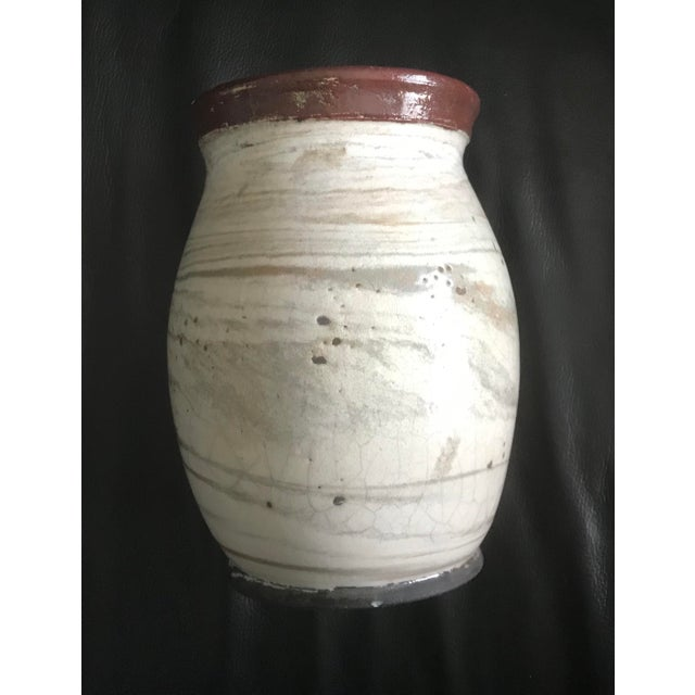 Beautiful cream studio vase for those spring flowers! - cream with grey dots on one size - brown rim -artist's signature...