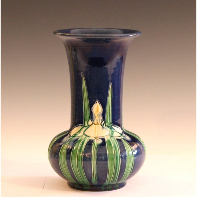 """Awaji pottery trumpet form vase with incised iris design on unusual blue ground, circa 1920. Measure: 8 1/4"""" high, 6""""..."""