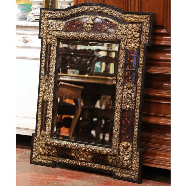 Created in France, circa 1870, the elegant antique wall mirror with overhang corners is rectangular in shape embellished...
