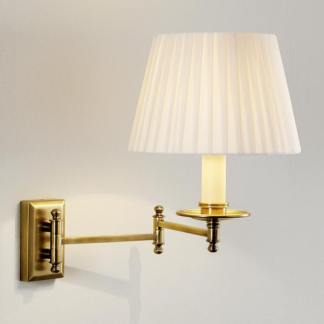Antique Brass (AB) wall light with detailed, quality swivel joints to allow directional movement. Also available in...