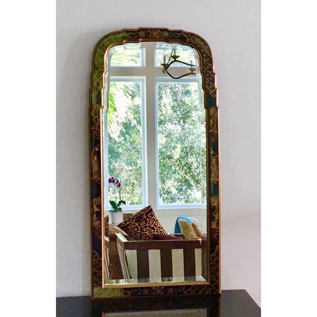 Chinoiserie black lacquered Queen Ann form mirror with hand painted decoration. A very pretty, classic piece. Well made...