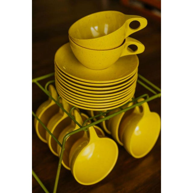 "10 speckled yellow melamine cups and saucers by Kenro Melmac. Dims: Cups: 4""R x 5.5""Wide with handle x 2""H Saucers: 6""R x..."