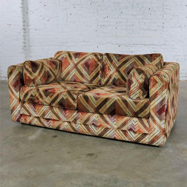 Awesome mod tuxedo loveseat length sofa upholstered in Jack Lenor Larsen style geometric fabric in shades of brown, rust,...