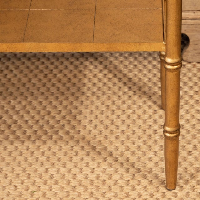 This small console table may be relatively small in size but it has big style! Constructed of wood with a gold leaf...