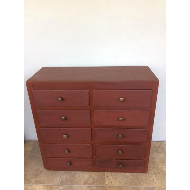 A custom made 10 drawer hand made cabinet from old boxes and recycled wood. This hand made cabinet has been painted using...
