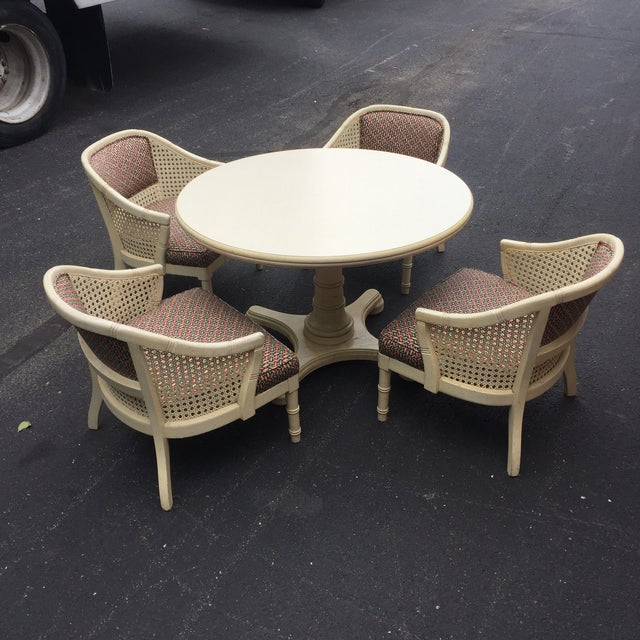 Great set of 4 cane barrel tub chairs and round table. This set is great ! Reupholster and lacquer and you have a unique...