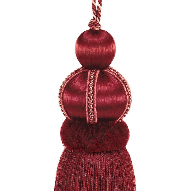 Elegant ruby red satin covered key tassel is made with a cut velvet ruche, decorative gimp and a twisted cord detail....