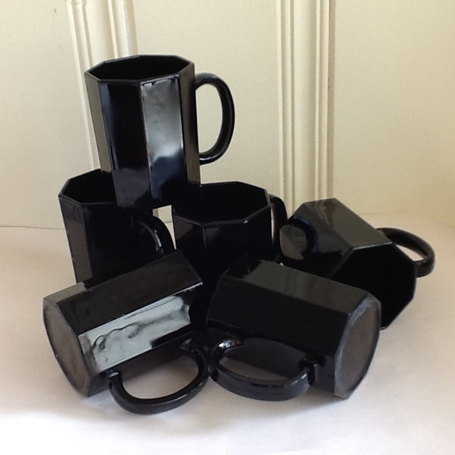Made in France, this set of six ceramic mugs or cups are elegantly sophisticated. Octagonal shape, perfect condition in...