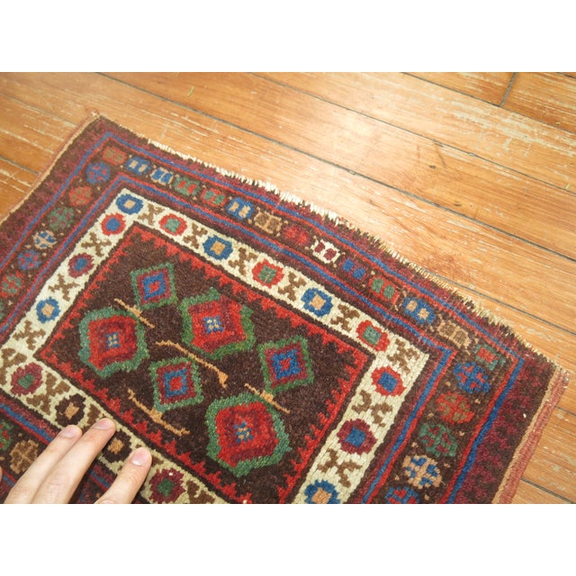 Small Textile Throw Rug from the early 20th century.