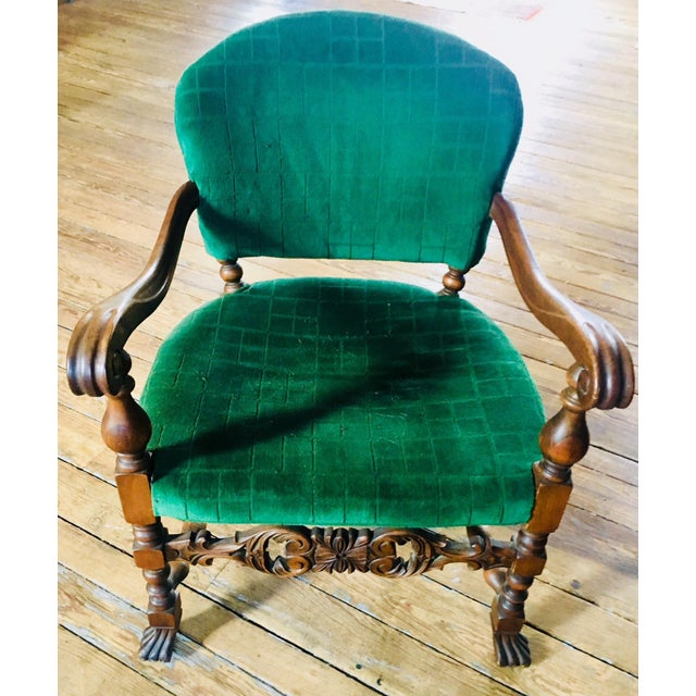 This walnut frame chair is generously proportioned and nicely carved cartouche style stretcher, trifid feet, and nicely...