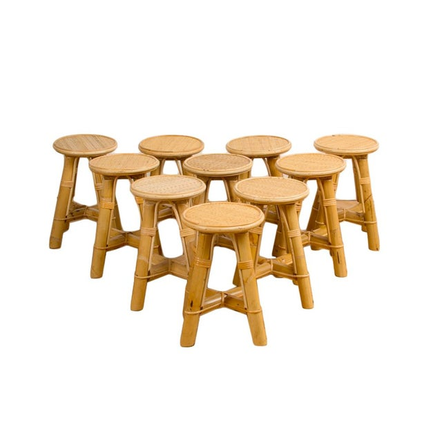 A set of small bamboo and rattan stools with tube legs and weaving structure which connects them under the seats. Priced...