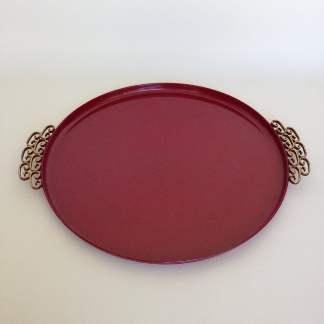A Mid-Century enameled round tray designed by Harry Allen Kyes. This Moire' Glaze enameled metal tray has a hand-hammered...