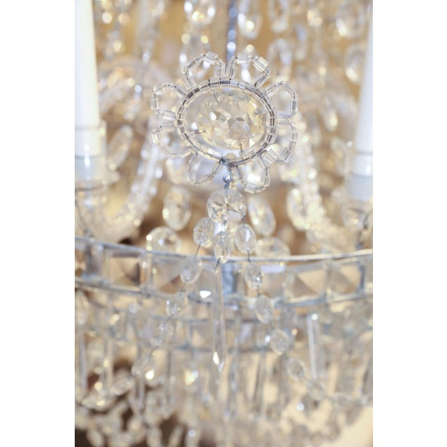 Large eight-light crystal chandelier from Italy (circa 1850-1860). Decorated in crystal prisms , beads and stunning...