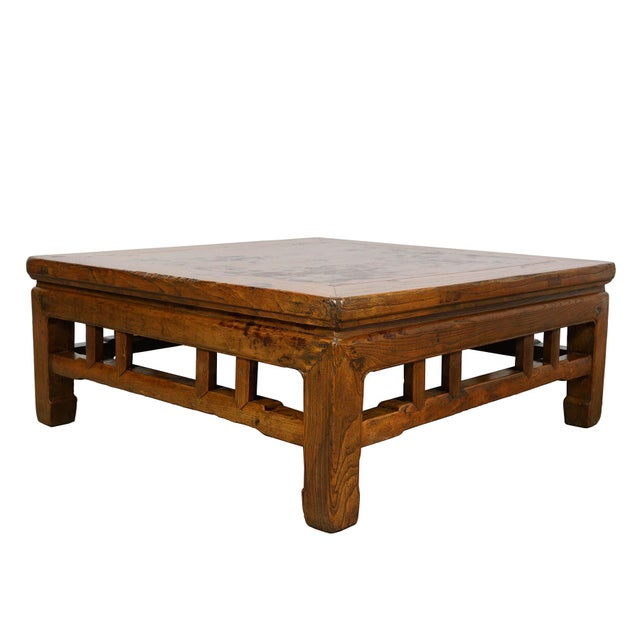 Look at this lovely Chinese antique carved coffee table. It is made from solid elm wood with carving works around the...