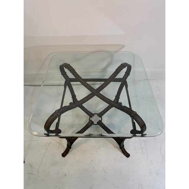 Signed Hermes Patinated Iron Equestrian Strap Form Table with Detailed Stitching and Center Bridle Ring. Patinated Brown...