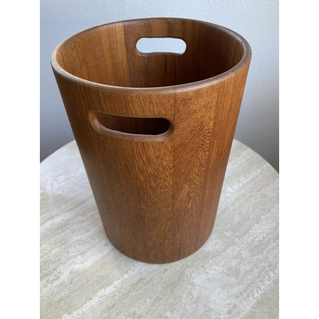 Vintage Danish Mid Century Modern Teak Wastebasket with handles. Thick wood with a nice patina and a label beneath that...