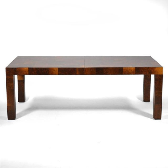 Paul Evans takes the minimalist form of a parsons table and gives it tremendous visual appeal by covering it in a...