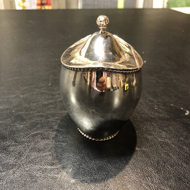 Oval tea caddy with age wear to silver plate. Hinge lid.