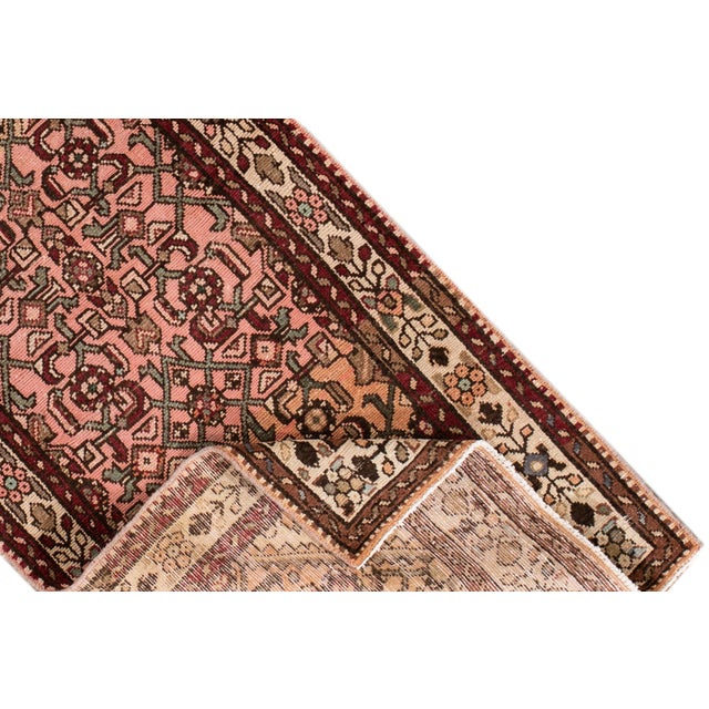 Vintage hand-knotted Persian rug with a geometrical medallion motif. This one of a kind piece has great colors and a...