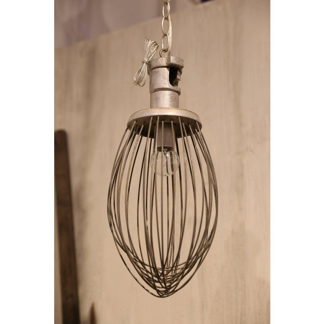 A commercial bakery whisk found in France takes a new turn as a pendant light fixture. With approximately 40 inches of...