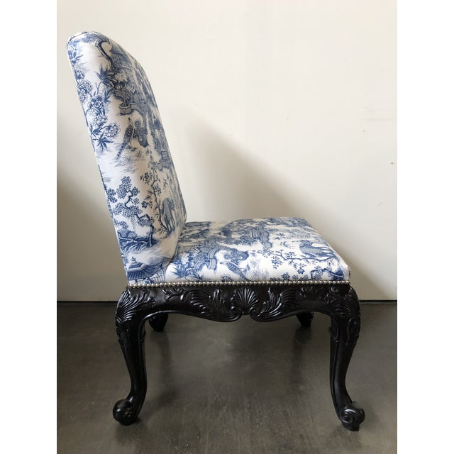 Georgian style chairs with carved legs in a dark mahogany finish. Tight upholstered back and seat with nail head trim...