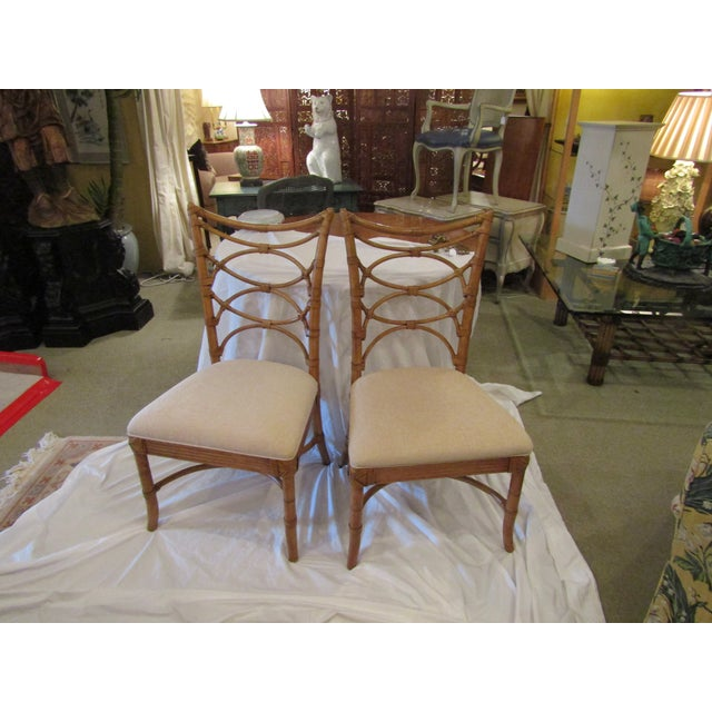 Tommy Bahama Home Beach House Sanibel Side Chair with Leather-Wrapped Bent Rattan Back. Upholstered seats. Matching table...
