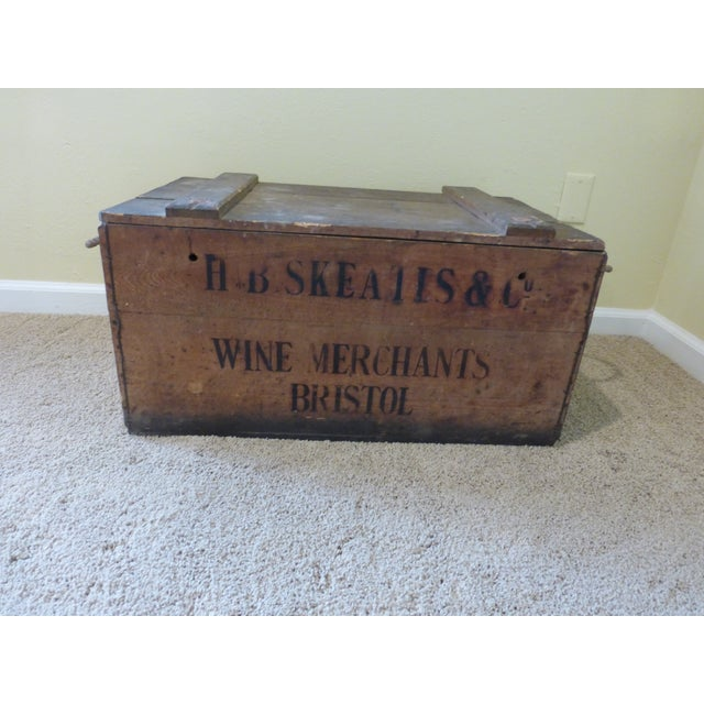 This authentic wooden wine crate is from H. B. Skeates & Co. , Bristol, England. The rope handles, brands on all sides and...