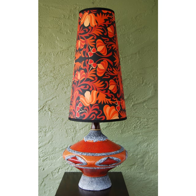 Wow! This is no ordinary lamp--it's a bold & exciting statement piece that will add a pop of vivid color to your design...