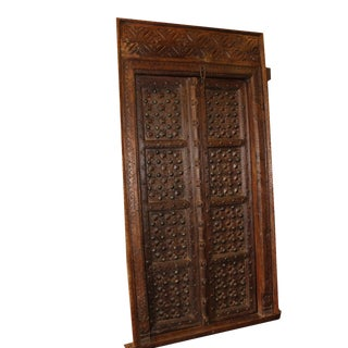 Antique Indian Carved Wooden Door With Metal Fittings & Frame For Sale