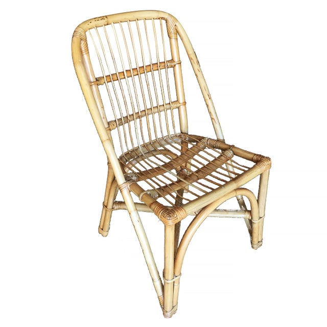 Vintage rattan dining room side chair with a stick rattan seat, included is a set of four chairs. Each chair features a...