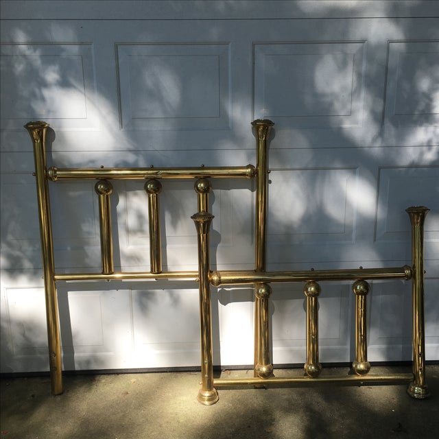 This twin-size headboard and footboard set is approximately 30 years old. Lovely, bold brass pieces. There are cracks on...