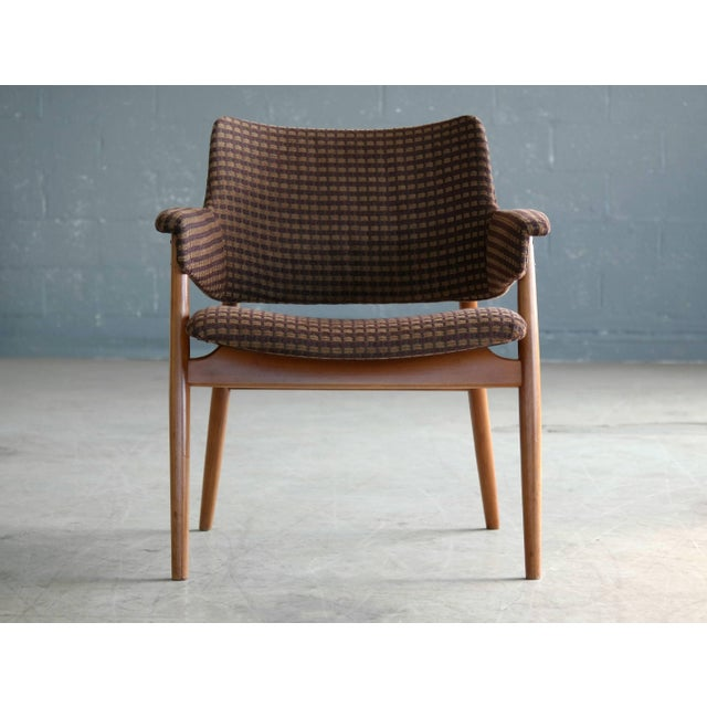 Classic 1950s small lounge or side chair in beech and fabric. The chair is very much in the style of Hans Olsen and some...