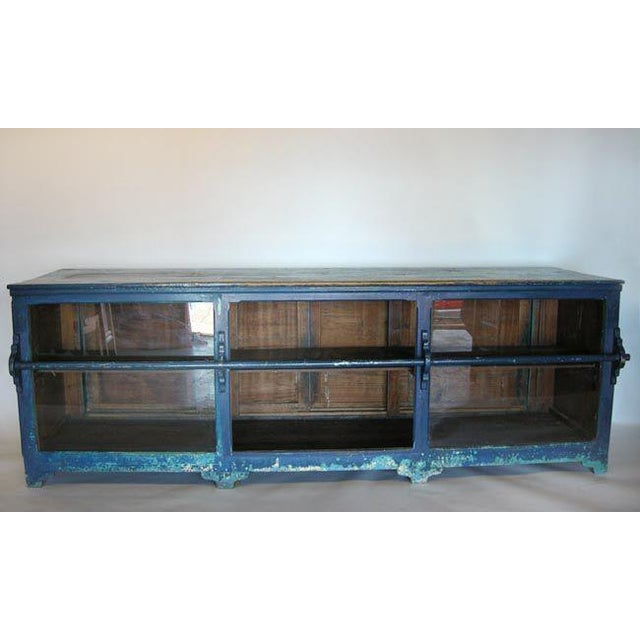 Antique mostrador - store counter, with layers of paint. Glass in front and four operable sliding doors in the back. Worn...