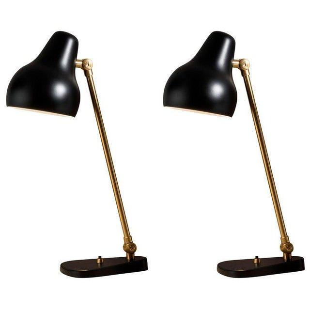 Vilhelm Lauritzen black 'Radiohus' table lamps for Louis Poulsen. The VL38 table lamp was originally designed in the 1930s...
