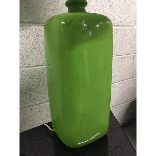 """Pair of green ceramic lamps. Measures: 32""""H (to top of finial) Under socket: 19"""" Body of lamps: 7"""" x 7"""" Shades not included."""