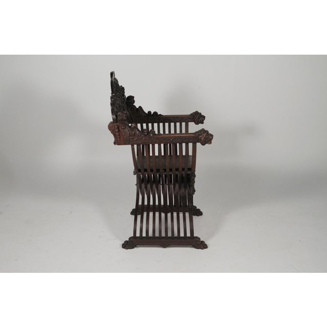 1890 Gothic Revival Heavily Carved Campaign Chair For Sale - Image 11 of 13