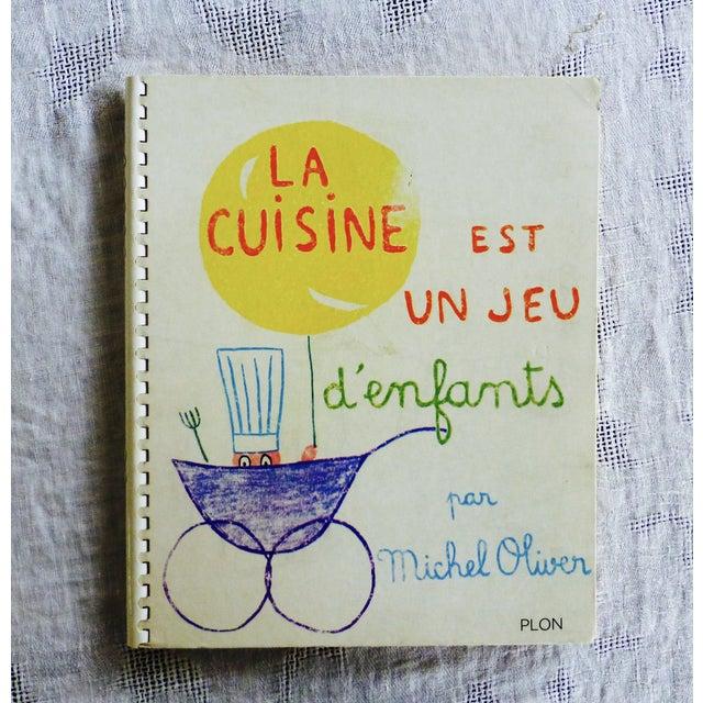 This is the rare, vintage, spiral-bound French children's cookbook - 'La Cuisine Est Un Jeu d'enfants.' Written in French,...