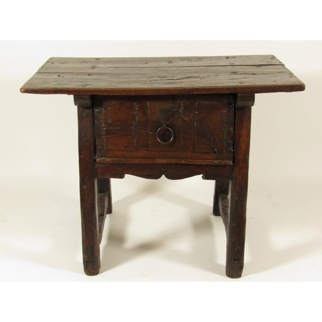 A 17th century Spanish stained sycamore one drawer stand with original iron hardware and rich original patina.