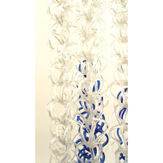 Italian Post-War Design (1960's) crystallized clear & blue glass in the form of interlocking rings suspended from a chrome...