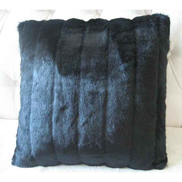 Pillow made of faux mink fabric. Down-like fill. The seller makes these in every size - if interested in a different size...