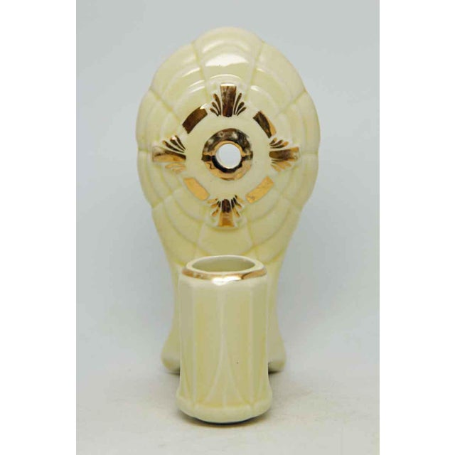 Sconces with gold enamel over ivory with has a yellowish hue. These are not wired-price reflects wiring included after...