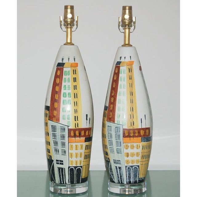 Pair of vintage Italian ceramic lamps by Bitossi, with hand painted sky line design. These lamps are big chunks, almost...
