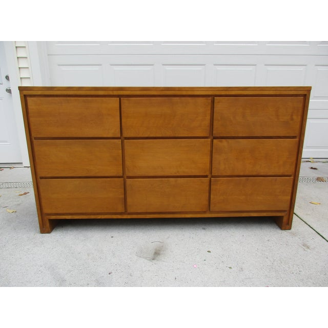 This dresser is often misattributed to Russel Wright, but is actually designed by Leslie Diamond. It has nine well-...