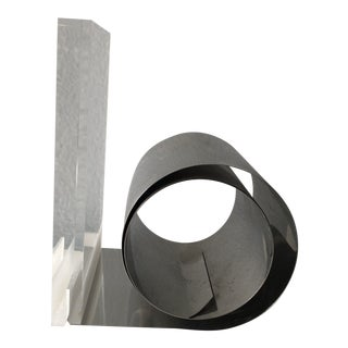 Acrylic and Brushed Steel Roll, Expandable Bookend For Sale