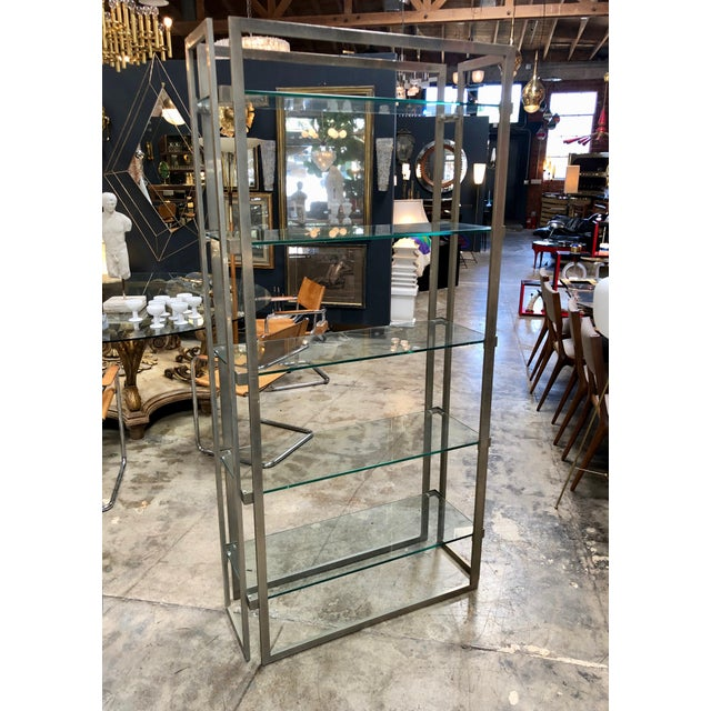 Willy Rizzo vintage chrome bookcase, Italy 1970s This striking vintage Italian chromebookcase, designed by Willy Rizzo,...