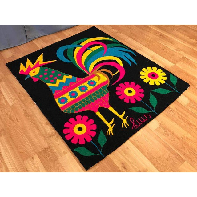 An exceptional hand-knotted yarn tapestry or rug depicting a proudly colorful rooster standing amid flowers by Venezuelan...