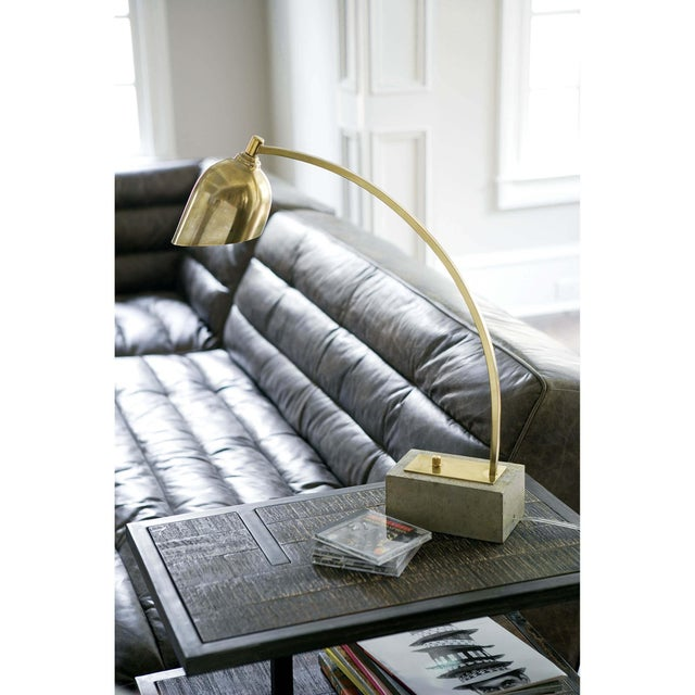 Add a bit of ambient light to your workspace or den with Eureka's elegantly arched natural brass neck and sleek metal...