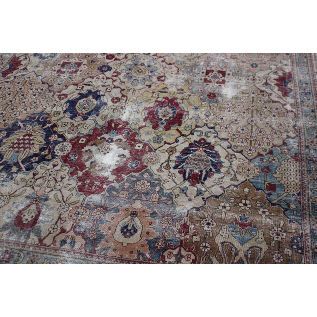 This stunning antique Tabriz rug was hand-knotted in the 1880's in Iran. Knotted with 75% wool and 25% cotton, dyed with...